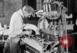 Image of Assembling engines in an Studebaker automobile plant South Bend Indiana USA, 1920, second 39 stock footage video 65675071729