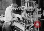 Image of Assembling engines in an Studebaker automobile plant South Bend Indiana USA, 1920, second 40 stock footage video 65675071729