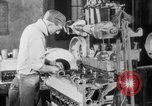 Image of Assembling engines in an Studebaker automobile plant South Bend Indiana USA, 1920, second 41 stock footage video 65675071729