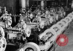 Image of Assembling engines in an Studebaker automobile plant South Bend Indiana USA, 1920, second 44 stock footage video 65675071729