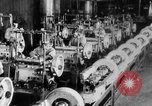 Image of Assembling engines in an Studebaker automobile plant South Bend Indiana USA, 1920, second 45 stock footage video 65675071729