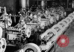 Image of Assembling engines in an Studebaker automobile plant South Bend Indiana USA, 1920, second 47 stock footage video 65675071729
