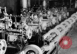 Image of Assembling engines in an Studebaker automobile plant South Bend Indiana USA, 1920, second 50 stock footage video 65675071729