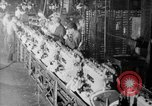 Image of Assembling engines in an Studebaker automobile plant South Bend Indiana USA, 1920, second 59 stock footage video 65675071729