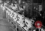 Image of Assembling engines in an Studebaker automobile plant South Bend Indiana USA, 1920, second 60 stock footage video 65675071729
