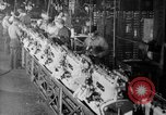 Image of Assembling engines in an Studebaker automobile plant South Bend Indiana USA, 1920, second 61 stock footage video 65675071729