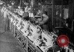 Image of Assembling engines in an Studebaker automobile plant South Bend Indiana USA, 1920, second 62 stock footage video 65675071729