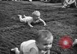 Image of baby crawling race New Jersey United States USA, 1945, second 40 stock footage video 65675072163
