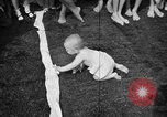 Image of baby crawling race New Jersey United States USA, 1945, second 54 stock footage video 65675072163