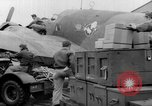Image of loading airplane with movies for troops overseas New York United States USA, 1943, second 15 stock footage video 65675072285