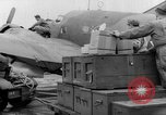 Image of loading airplane with movies for troops overseas New York United States USA, 1943, second 16 stock footage video 65675072285