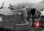 Image of loading airplane with movies for troops overseas New York United States USA, 1943, second 20 stock footage video 65675072285