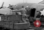 Image of loading airplane with movies for troops overseas New York United States USA, 1943, second 22 stock footage video 65675072285