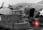 Image of loading airplane with movies for troops overseas New York United States USA, 1943, second 23 stock footage video 65675072285