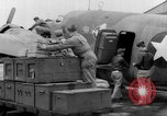 Image of loading airplane with movies for troops overseas New York United States USA, 1943, second 24 stock footage video 65675072285