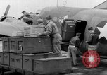 Image of loading airplane with movies for troops overseas New York United States USA, 1943, second 27 stock footage video 65675072285