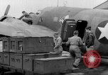 Image of loading airplane with movies for troops overseas New York United States USA, 1943, second 36 stock footage video 65675072285