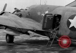 Image of loading airplane with movies for troops overseas New York United States USA, 1943, second 52 stock footage video 65675072285