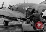 Image of loading airplane with movies for troops overseas New York United States USA, 1943, second 59 stock footage video 65675072285