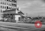 Image of civilians wait for streetcar Hiroshima Japan, 1946, second 18 stock footage video 65675072450
