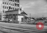 Image of civilians wait for streetcar Hiroshima Japan, 1946, second 19 stock footage video 65675072450