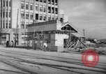 Image of civilians wait for streetcar Hiroshima Japan, 1946, second 20 stock footage video 65675072450