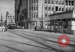 Image of civilians wait for streetcar Hiroshima Japan, 1946, second 23 stock footage video 65675072450