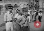 Image of civilians wait for streetcar Hiroshima Japan, 1946, second 36 stock footage video 65675072450