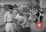 Image of civilians wait for streetcar Hiroshima Japan, 1946, second 37 stock footage video 65675072450