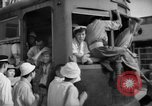 Image of civilians wait for streetcar Hiroshima Japan, 1946, second 40 stock footage video 65675072450