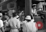 Image of civilians wait for streetcar Hiroshima Japan, 1946, second 41 stock footage video 65675072450