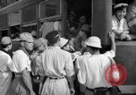 Image of civilians wait for streetcar Hiroshima Japan, 1946, second 44 stock footage video 65675072450