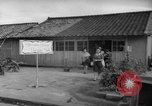 Image of civilians wait for streetcar Hiroshima Japan, 1946, second 45 stock footage video 65675072450