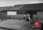 Image of civilians wait for streetcar Hiroshima Japan, 1946, second 46 stock footage video 65675072450