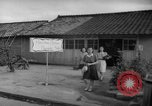 Image of civilians wait for streetcar Hiroshima Japan, 1946, second 47 stock footage video 65675072450