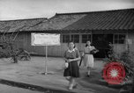 Image of civilians wait for streetcar Hiroshima Japan, 1946, second 48 stock footage video 65675072450