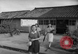Image of civilians wait for streetcar Hiroshima Japan, 1946, second 49 stock footage video 65675072450