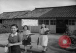 Image of civilians wait for streetcar Hiroshima Japan, 1946, second 50 stock footage video 65675072450