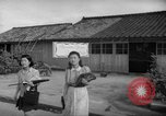 Image of civilians wait for streetcar Hiroshima Japan, 1946, second 51 stock footage video 65675072450