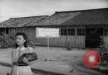Image of civilians wait for streetcar Hiroshima Japan, 1946, second 52 stock footage video 65675072450