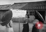 Image of civilians wait for streetcar Hiroshima Japan, 1946, second 53 stock footage video 65675072450
