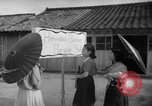 Image of civilians wait for streetcar Hiroshima Japan, 1946, second 55 stock footage video 65675072450