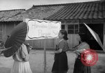 Image of civilians wait for streetcar Hiroshima Japan, 1946, second 57 stock footage video 65675072450