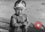 Image of civilians wait for streetcar Hiroshima Japan, 1946, second 58 stock footage video 65675072450