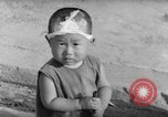 Image of civilians wait for streetcar Hiroshima Japan, 1946, second 61 stock footage video 65675072450