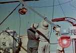 Image of Hoisting of Gadget atomic bomb before Trinity nuclear test Alamogordo New Mexico USA, 1945, second 14 stock footage video 65675072463