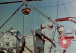 Image of Hoisting of Gadget atomic bomb before Trinity nuclear test Alamogordo New Mexico USA, 1945, second 15 stock footage video 65675072463