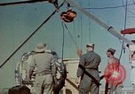 Image of Hoisting of Gadget atomic bomb before Trinity nuclear test Alamogordo New Mexico USA, 1945, second 19 stock footage video 65675072463
