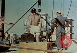 Image of Hoisting of Gadget atomic bomb before Trinity nuclear test Alamogordo New Mexico USA, 1945, second 23 stock footage video 65675072463