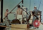 Image of Hoisting of Gadget atomic bomb before Trinity nuclear test Alamogordo New Mexico USA, 1945, second 24 stock footage video 65675072463